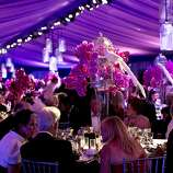 Peacock centerpieces decorate the tables in a tent outside War Memorial Opera House during the San Francisco Opera Opening Night Gala in San Francisco, Calif., on September 7, 2012.  The decor for the event was designed by Robert Fountain.