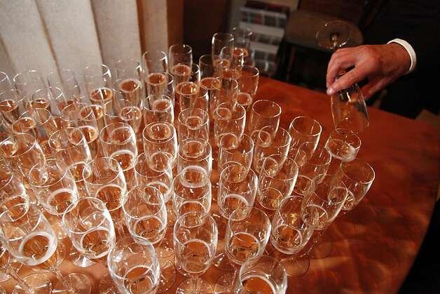 An opera goer fills his champagne glass to the top after watching the season opening performance of the San Francisco Opera's 90th Season on Friday, Sept. 7, 2012. Photo: Alex Washburn, Special To The Chronicle