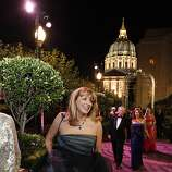 Cathy MacNaughton, co-chair of the gala night, makes her way to the tent for the afterparty.