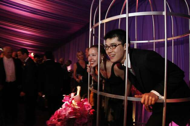 Lauren Murrow and Jan Lui take photos in a giant bird cage during the after party of the Opera Ball celebrating the San Francisco Opera's 90th Season on Friday, Sept. 7, 2012. Photo: Alex Washburn, Special To The Chronicle