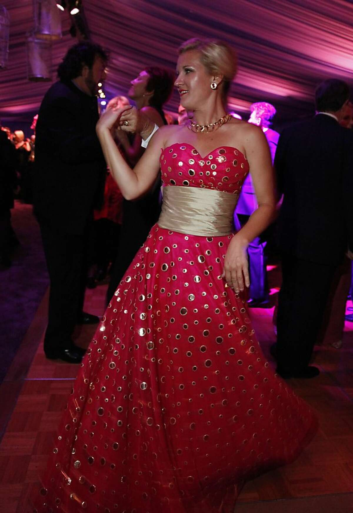 Danielle Mott dances during the after party of the San Francisco Opera's Opera Ball marking the beginning of its 90th season on Friday, Sept. 7, 2012. Those in attendance were entertained with Giuseppe Verdi?•s Rigoletto conducted by Music Director Nicola Luisotti for the season opener.