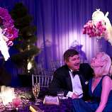 Michael Trinnan and Amanda Wallis sit for dinner before the performance begins in the tented Opera Ball Pavilion, designed by Robert Fountain.