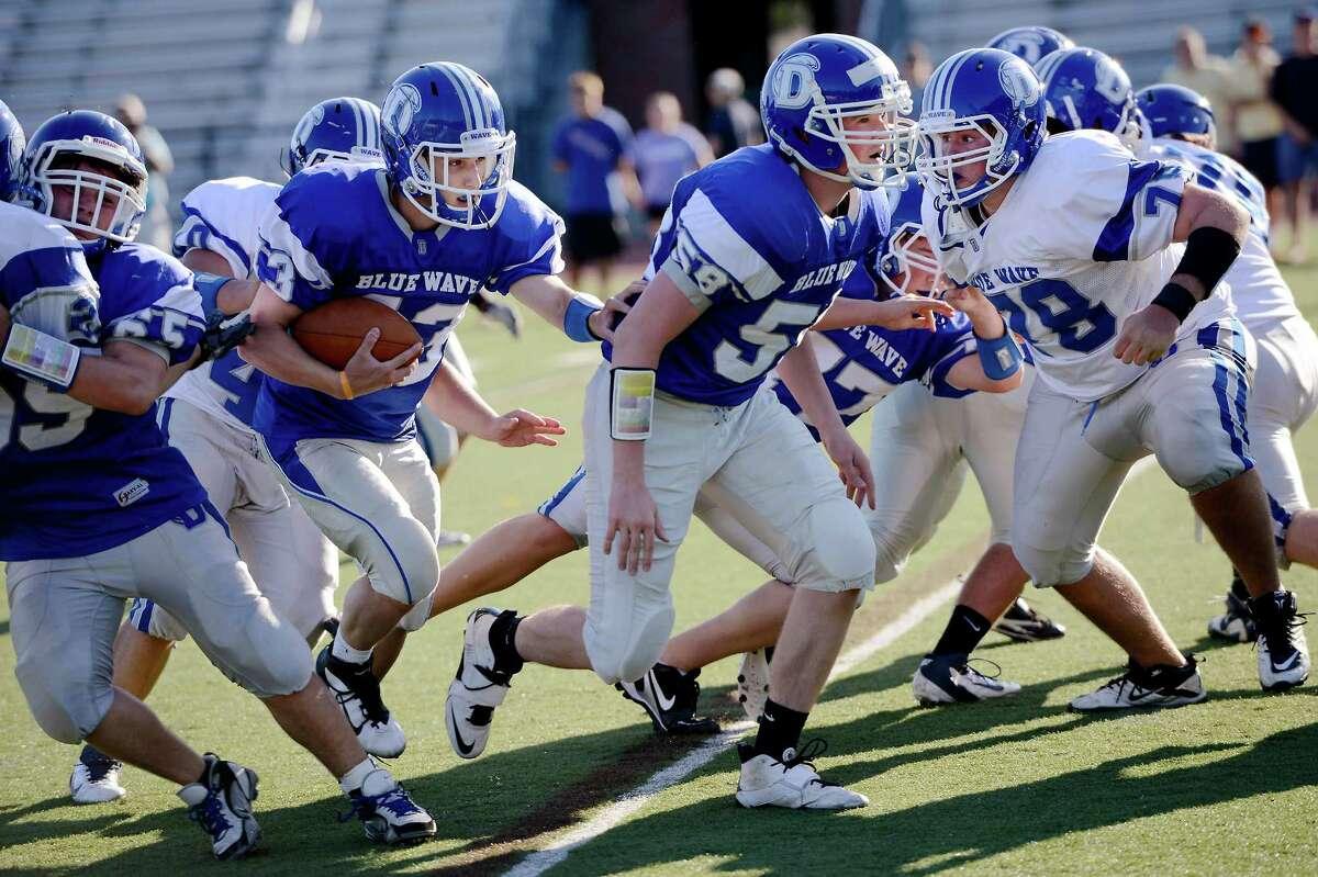 Darien High School's Jay Harrison (#43) follows his blocker Jack Tyrell (#58) during the annual blue/white Spring football scrimmage at Darien High School, Darien CT on Sunday June 17th, 2012.