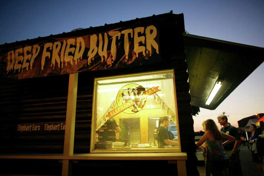 A booth sells deep-fried butter during the opening day of the Puyallup Fair on Friday, September 7, 2012. The fair, one of the largest in the county, runs until September 23rd. Photo: JOSHUA TRUJILLO / SEATTLEPI.COM