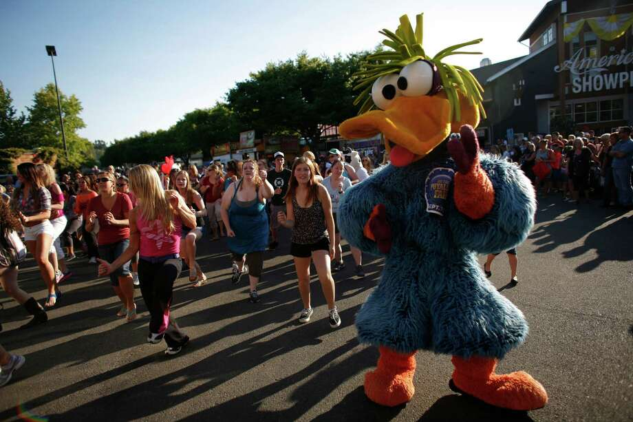 One of the Puyallup Fair mascots participates in a flash mob during the opening day of the Puyallup Fair on Friday, September 7, 2012. The fair, one of the largest in the county, runs until September 23rd. Photo: JOSHUA TRUJILLO / SEATTLEPI.COM
