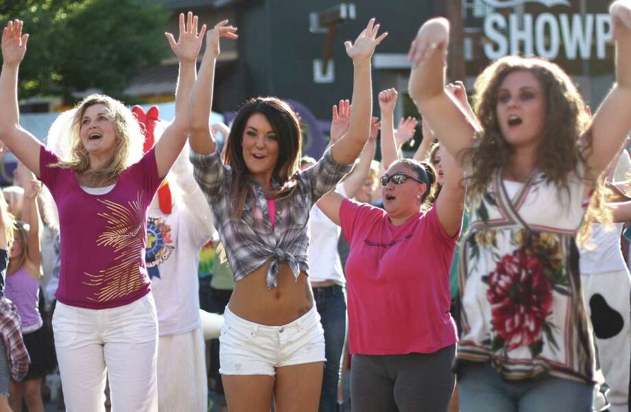 People dance during a flash mob performance on the opening day of the Puyallup Fair on Friday, September 7, 2012. The fair, one of the largest in the county, runs until September 23rd. Photo: JOSHUA TRUJILLO / SEATTLEPI.COM