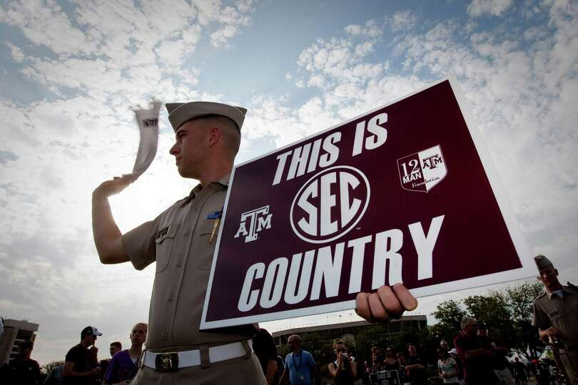 John Benson, of Austin the Fighting Texas Aggie Band waves his towel as ESPN's College Gameday airs