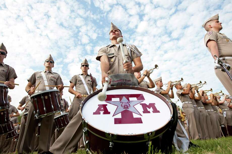 Carter Ray, of Floresville, plays 'When Johnny Comes Marching Home' with the Fighting Texas Aggie Band during the airing of ESPN's College Game Day. Photo: Nick De La Torre, Houston Chronicle / © 2012  Houston Chronicle