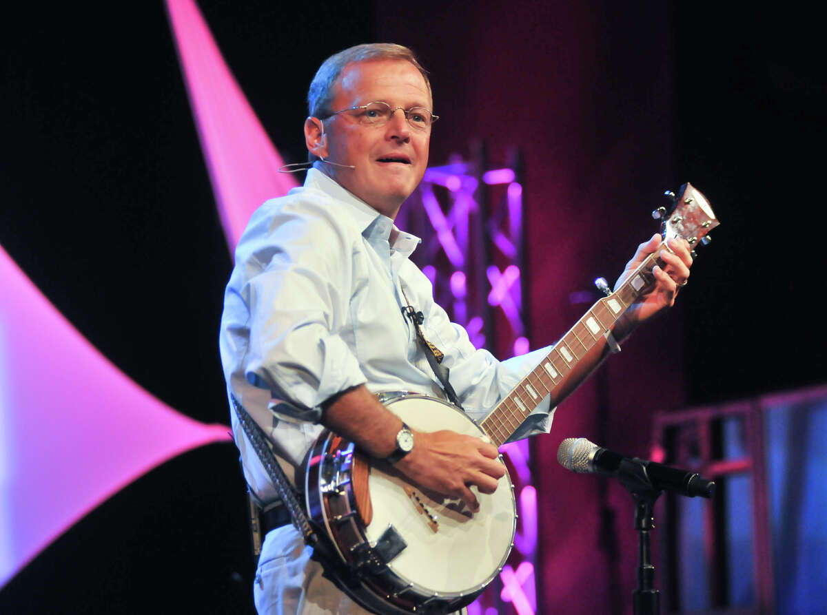 """Senior minister Randy Frazee strums during a service. """"Playing the banjo,"""" he says, """"is letting my hair down and being fun."""""""