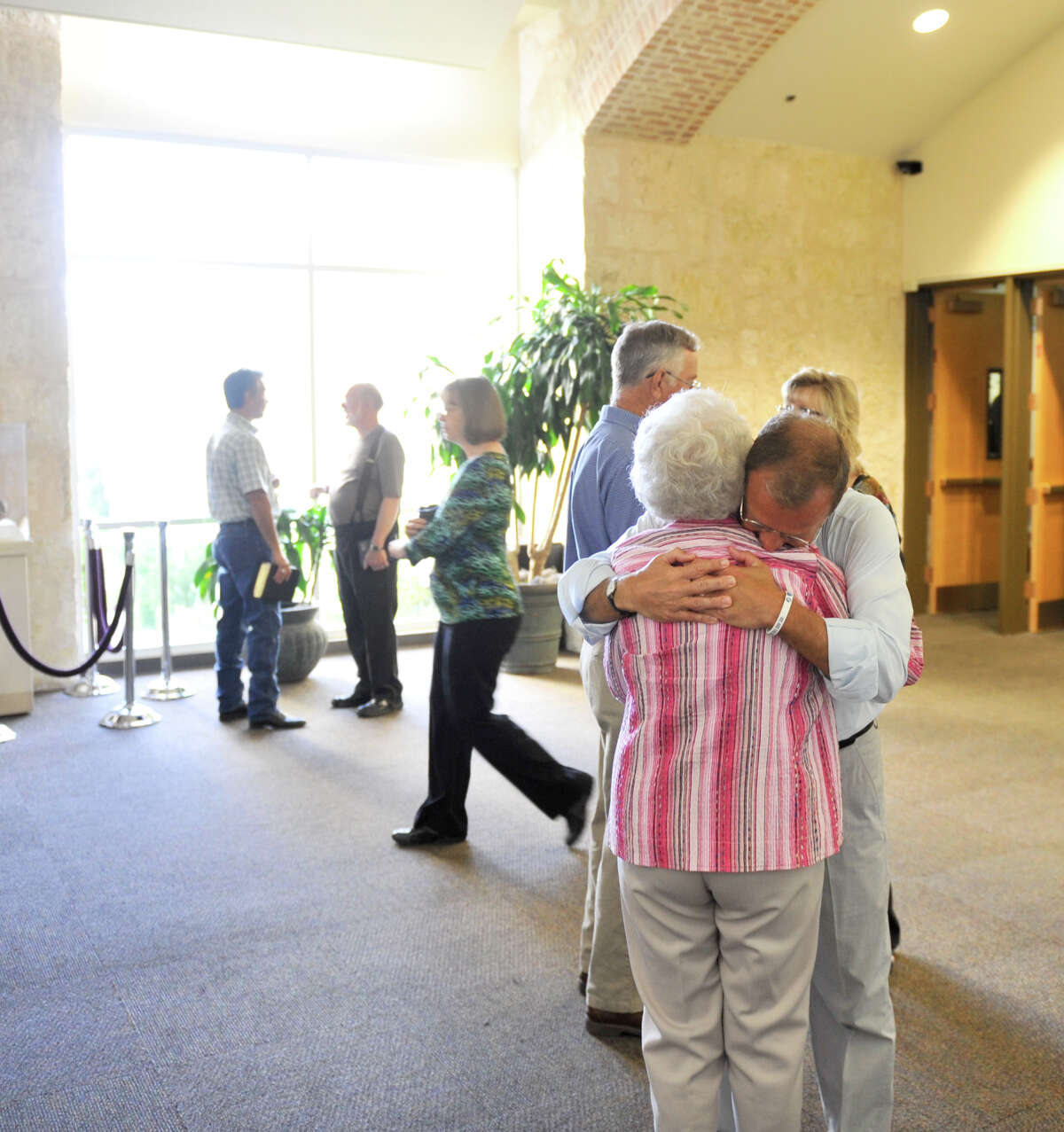 """Senior minister Randy Frazee hugs a church member following a service at Oak Hills Church. He says he and Max Lucado """"both agreed this partnership has added years to our lives."""" Both men also say that the dual-minister setup, while rare for large churches, plays to their strengths."""