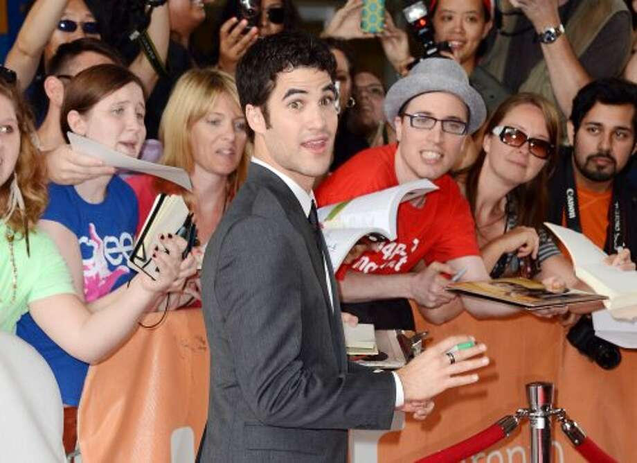 "Darren Criss signs autographs at the ""Imogen"" premiere during the 2012 Toronto International Film Festival on Sept. 7, 2012.  (Mark Davis / Getty Images)"