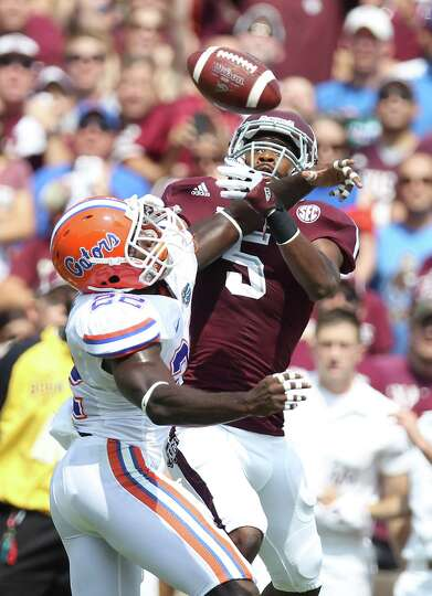 University of Florida defensive back Hugh Miles (22) breaks up a pass intended for Texas A&M Univers
