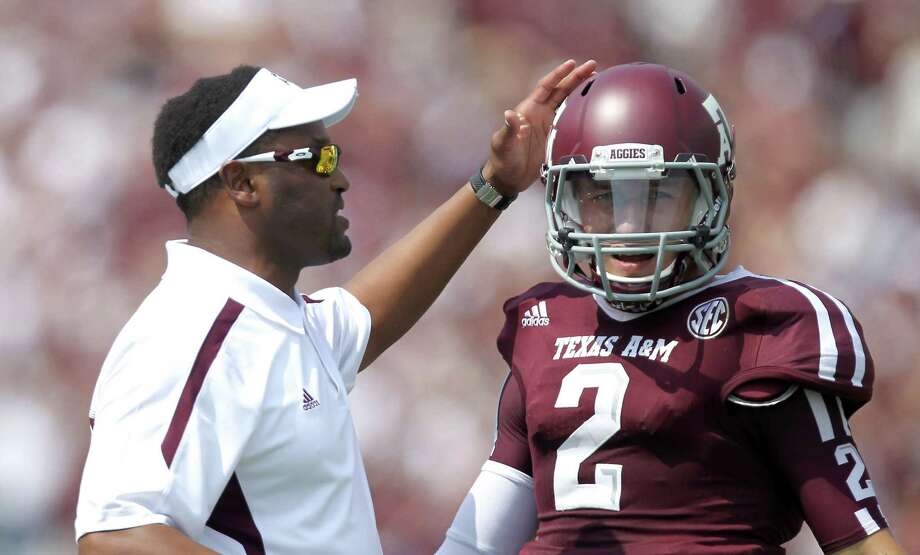 Texas A&M University head coach Kevin Sumlin pats Texas A&M University quarterback Johnny Manziel (2) after Manziel was called for an illegal forward pass during the first quarter. Photo: Nick De La Torre, Houston Chronicle / © 2012  Houston Chronicle