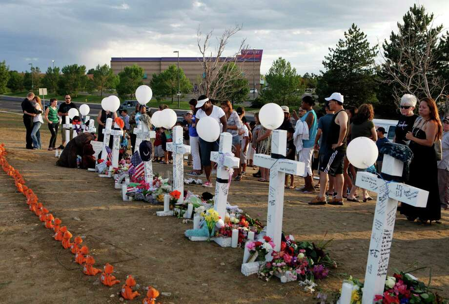 Recent mass shootings have left the nation grieving but still divided on the subject of gun control and whether people with concealed weapons can be effective in ending such incidents. Photo: Ed Andrieski / AP