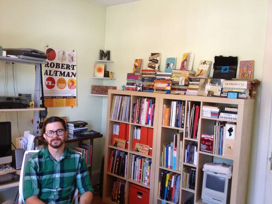 Graphic designer Phil Pascuzzo in his Albany home office. (Alli Knothe/Times Union)