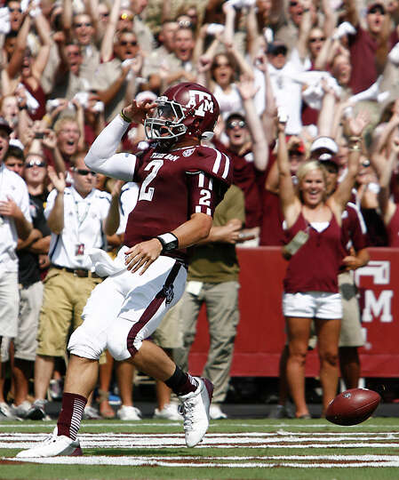 Texas A&M University quarterback Johnny Manziel (2) salutes the crowd after he scores a touchdown on