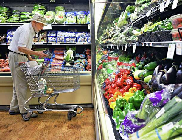 Regular customer Edgar Snell of Niskayuna shops in the newly renovated Niskayuna Food Co-op Friday Sept. 7, 2012. (John Carl D'Annibale / Times Union) Photo: John Carl D'Annibale / 00019190A