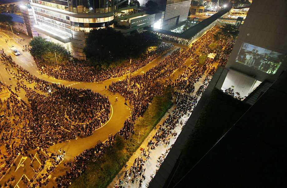 Thousands outside Hong Kong government buildings protest plans for Chinese patriotism classes. Photo: Kin Cheung, Associated Press