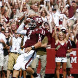 Texas A&M University quarterback Johnny Manziel (2) salutes the crowd after he scores a touchdown on a boot leg during the second quarter of a NCAA football game against University of Florida, Saturday, Sept. 8, 2012, at Kyle Field in College Station.