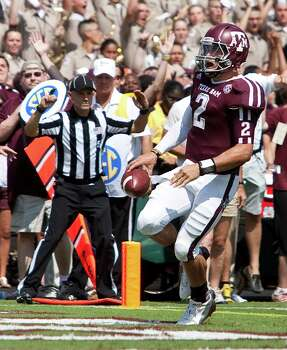 Texas A&M University quarterback Johnny Manziel (2) scores a touchdown on a boot leg during the second quarter of a NCAA football game against University of Florida, Saturday, Sept. 8, 2012, at Kyle Field in College Station. Photo: Nick De La Torre, Houston Chronicle / © 2012  Houston Chronicle