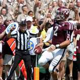 Texas A&M University quarterback Johnny Manziel (2) scores a touchdown on a boot leg during the second quarter of a NCAA football game against University of Florida, Saturday, Sept. 8, 2012, at Kyle Field in College Station.
