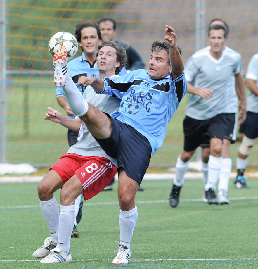 Friendly soccer match organized by Argentinian native and Greenwich resident, Matias Ortuno, at right, between his club, La Peña and El Chacarero of Miami at Greenwich High School, Saturday afternoon, Sept. 8, 2012. The match was played in honor of Riardo D'Amato, an El Chacarero player who passed away last year. Photo: Bob Luckey / Greenwich Time