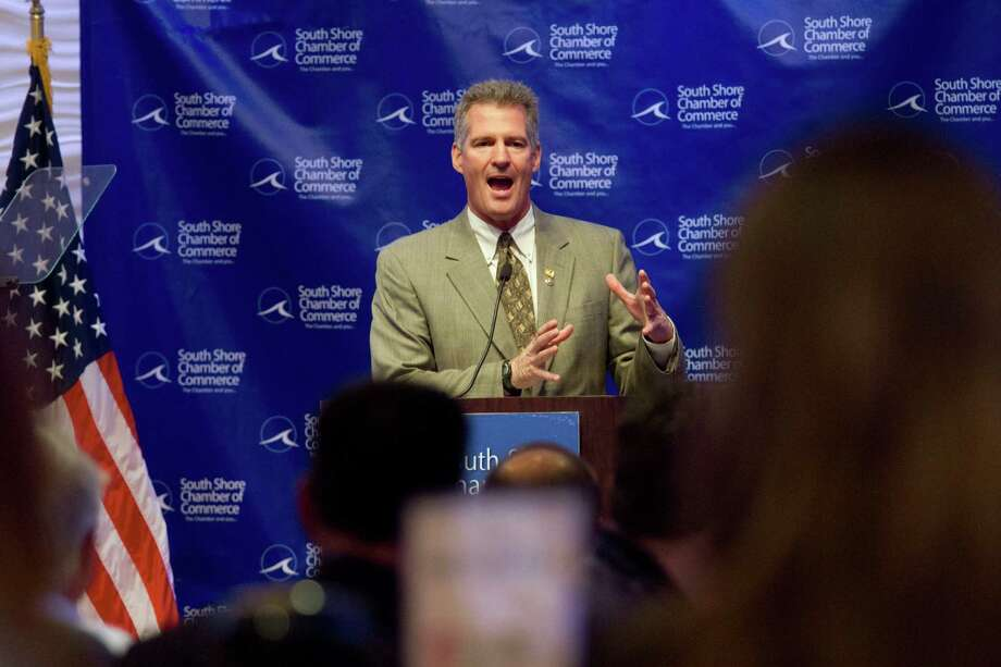 FILE -- Sen Scott Brown (R-Mass.) addresses the South Shore Chamber of Commerce in Randolph, Mass., Aug. 14, 2012. Brown, in a tight race with his Democratic rival, Elizabeth Warren, is featuring President Barack Obama complimenting him in a new ad. Photo: ERIK JACOBS, New York Times / NYTNS