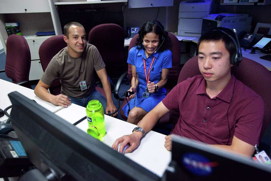 Matt Heverly (from left) and Vandi Tompkins, drivers for the Mars Curiosity, look at data from the Red Planet with Justin Linn, a mission controller, at the Jet Propulsion Laboratory. Heverly leads a team of 16 drivers who are responsible for steering the rover across the Red Planet's Gale Crater. Photo: MONICA ALMEIDA, New York Times / NYTNS