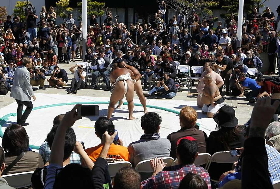 A large gathers at Japantown's Peace Plaza to watch sumo wrestling heavyweights demonstrate the sport in San Francisco, Calif. on Saturday, Sept. 8, 2012. Photo: Paul Chinn, The Chronicle