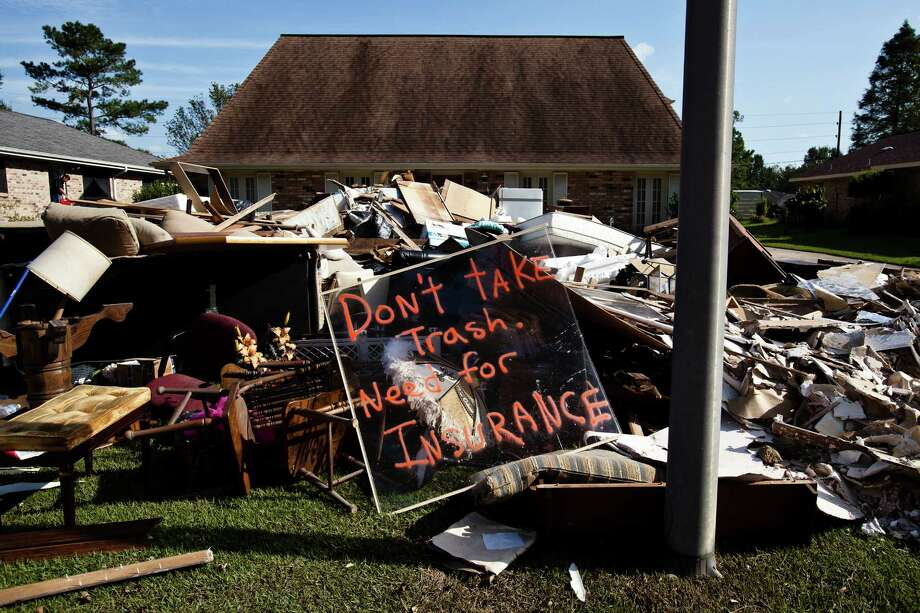 Many of those living outside of the newly erected levees around New Orleans, including residents of LaPlace, found themselves flooded by Hurricane Isaac and want the federal government to erect walls for them as well. Photo: WILLIAM WIDMER / NYTNS