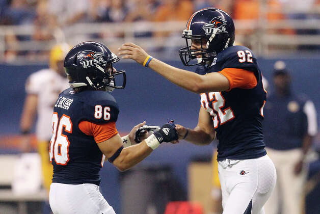UTSA kicker Sean Ianno (92) and Seth Grubb (86) celebrate after a successful field goal made against Texas A&M-Commerce in the first half at the Alamodome on Saturday, Sept. 8, 2012. Photo: Kin Man Hui, Express-News / ©2012 San Antonio Express-News