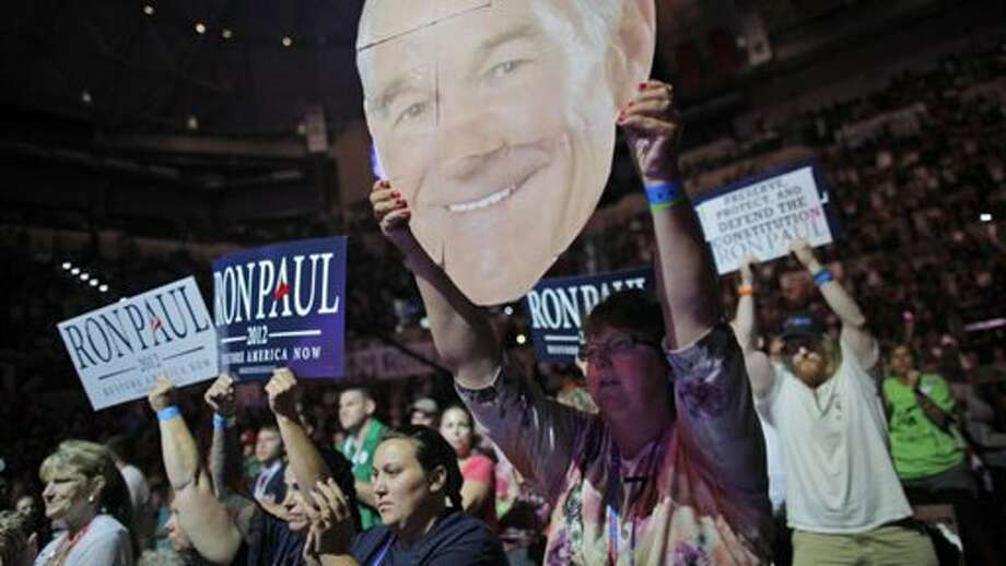 A Ron Paul backers hoisted a giant cutout of the candidate's head at a Tampa rally the Sunday before the GOP convention. (ABC News)