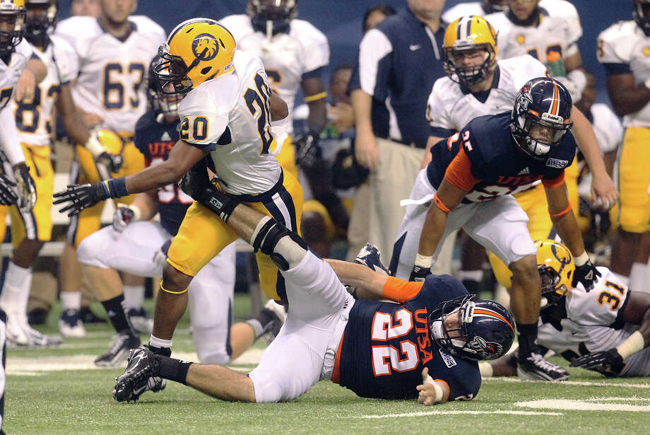 UTSA's Nic Johnston (22) uses every effort to stop a return run by Texas A&M-Commerce's Israel Hughes (20) in the first half at the Alamodome on Saturday, Sept. 8, 2012. Photo: Kin Man Hui, Express-News / ©2012 San Antonio Express-News