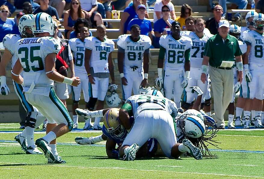 Tulane's Devon Walker (right) fractured his spine when he collided with teammate Julius Warmsley.