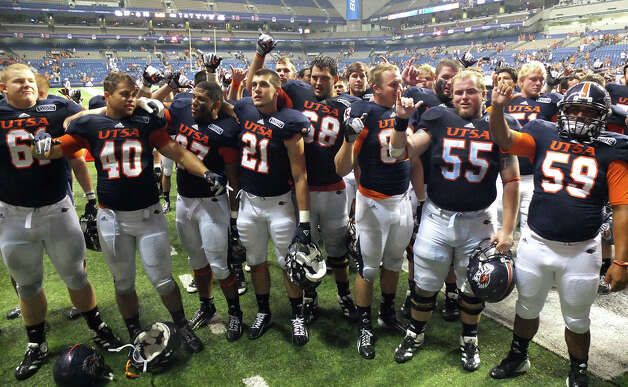 The UTSA Roadrunners sing the school song after their victory over Texas A&M-Commerce at the Alamodome on Saturday, Sept. 8, 2012. The Roadrunners defeated the Lions, 27-16. Over 30,000 were in attendance. Photo: Kin Man Hui, Express-News / ©2012 San Antonio Express-News