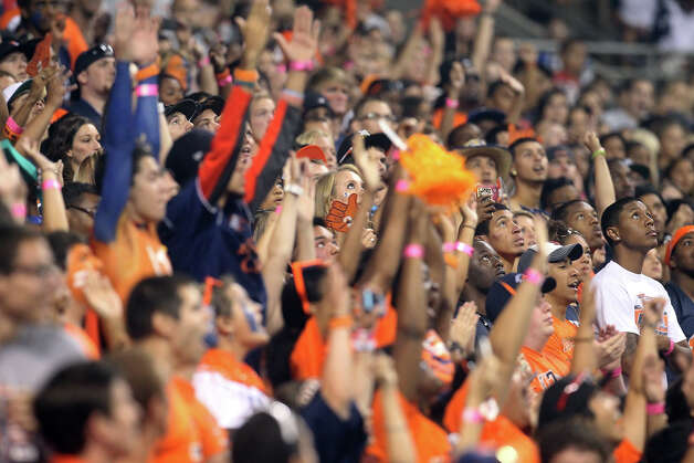 UTSA students keep their eyes on a score from their team against Texas A&M-Commerce in the first half at the Alamodome on Saturday, Sept. 8, 2012. Photo: Kin Man Hui, Express-News / ©2012 San Antonio Express-News