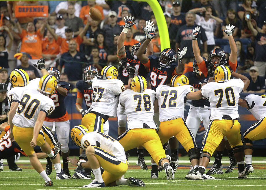 The UTSA defensive line attempts a block against Texas A&M-Commerce kicker Jacob O'Neil (90) in the first half at the Alamodome on Saturday, Sept. 8, 2012. Photo: Kin Man Hui, Express-News / ©2012 San Antonio Express-News
