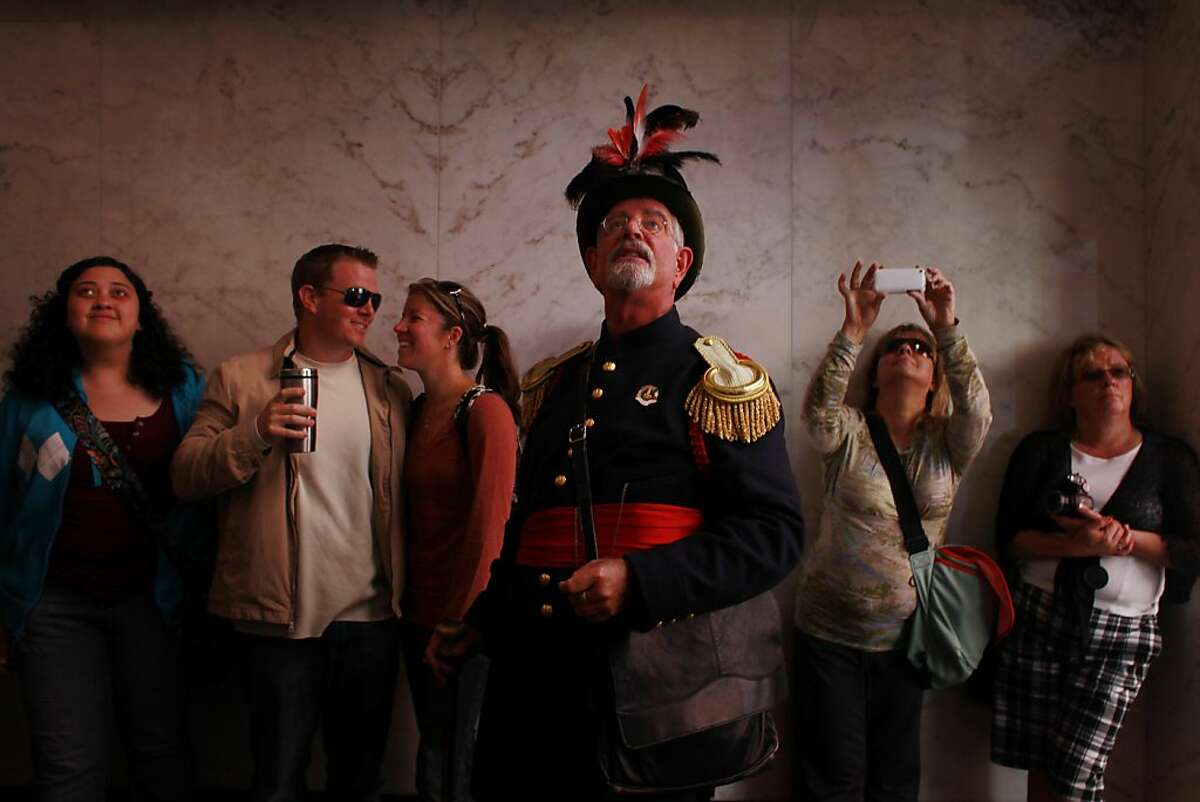 Pointing out historic highlights in the Monadnock Building on Market Street, Joseph Armsted, dressed as San Francisco's famed eccentric Emperor Norton, conducts a tour on Thursday Sep. 6, 2012 in San Francisco, Calif.