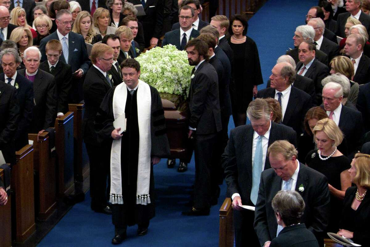 The reverend Dr. Brent Beasley leads the processional as the pall bearers carry the casket of Van Cliburn into Broadway Baptist Church in Fort Worth, Texas, Sunday, March 3, 2013. The internationally famous musician died this week. (Joyce Marshall/Fort Worth Star-Telegram/MCT)