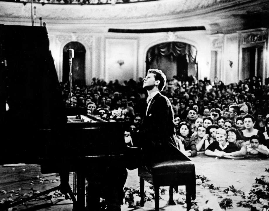 In this photo provided by the Van Cliburn Foundation, Texas pianist Van Cliburn performs to a packed audience in the Great Hall of the Moscow Conservatory in Moscow, Russia, in April 1958 during the first International Tchaikovsky Competition, which he won.  Van Cliburn has been diagnosed with advanced bone cancer and is resting comfortably at his Texas home, his publicist said Monday Aug. 27, 2012.  (AP Photo/Courtesy of Van Cliburn Foundation, file) Photo: Anonymous, Associated Press / Van Cliburn Foundation