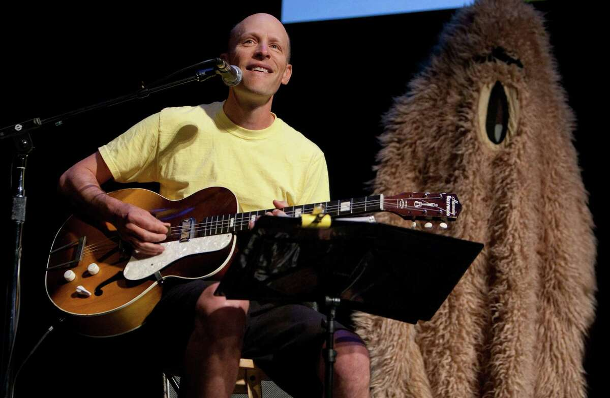 Musician Chris Ballew, a Patches Pal himself, performs a song he wrote about JP Patches during a celebration of JP Patches after the July death of Chris Wedes, the actor who played the iconic character. At right is