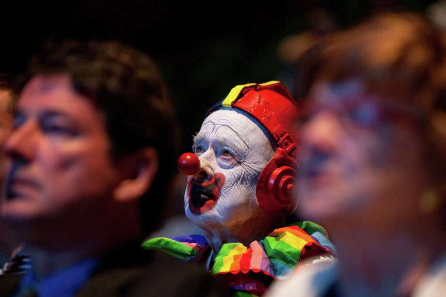 People watch a video presentation during a celebration of JP Patches after the July death of Chris Wedes, the actor who played the iconic character. Thousands gathered in McCaw Hall on Saturday, September 8, 2012 to honor Wedes and the beloved character he gave to children and their parents. Photo: JOSHUA TRUJILLO / SEATTLEPI.COM