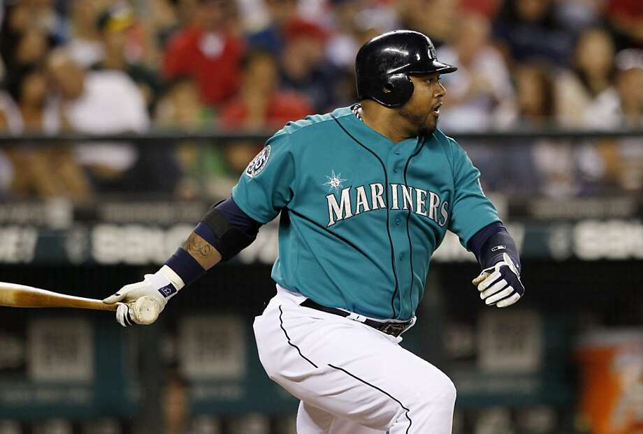 Seattle Mariners' Luis Jimenez singles against the Oakland Athletics in the fourth inning of a baseball game, Friday, Sept. 7, 2012, in Seattle. (AP Photo/Elaine Thompson) Photo: Elaine Thompson, Associated Press