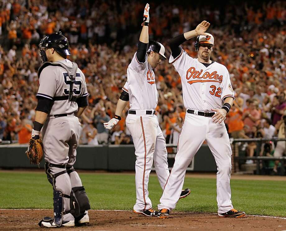 Mark Reynolds (center) and Matt Wieters (right) are two reasons the Orioles have hung with the Yankees. Photo: Rob Carr, Getty Images