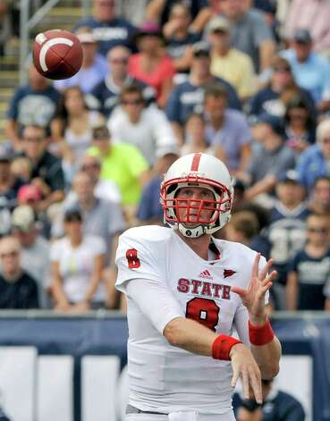 North Carolina State's Mike Glennon throws a pass in the second half of North Carolina's 10-7 victory over Connecticut in their NCAA college football game in East Hartford, Conn., on Saturday, Sept. 8, 2012. (AP Photo/Fred Beckham) Photo: Fred Beckham, Associated Press / FR153656 AP