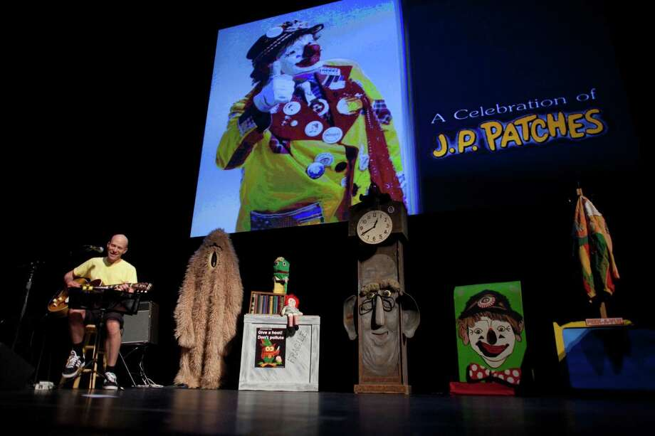 "Musician Chris Ballew, a Patches Pal himself, performs a song he wrote about JP Patches during a celebration of JP Patches after the July death of Chris Wedes, the actor who played the iconic character. At right is ""Ggoorrsstt the Friendly Frpl,"" one of the characters from the show. Thousands gathered in McCaw Hall on Saturday, September 8, 2012 to honor Wedes and the beloved character he gave to children and their parents. Photo: JOSHUA TRUJILLO / SEATTLEPI.COM"