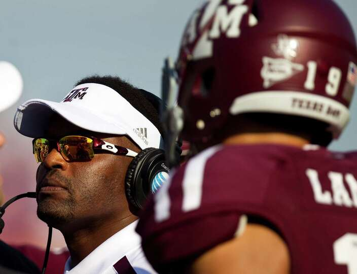 Texas A&M University head coach Kevin Sumlin talks to his players during a time out during the third