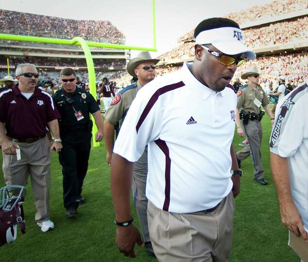 Texas A&M University head coach Kevin Sumlin walks off the field after loosing to University of Flor