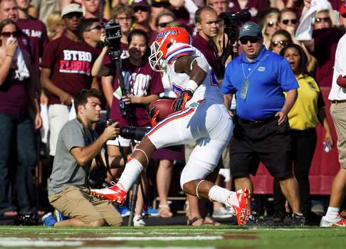 University of Florida running back Mike Gillislee (23) scores the go ahead touch down during the fourth quarter of a NCAA football game against Texas A&M University, Saturday, Sept. 8, 2012, at Kyle Field in College Station. The University of Florida won 20-17. Photo: Nick De La Torre, Houston Chronicle / © 2012  Houston Chronicle