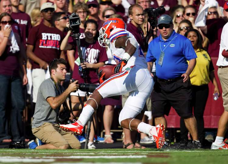 University of Florida running back Mike Gillislee (23) scores the go ahead touch down during the fou